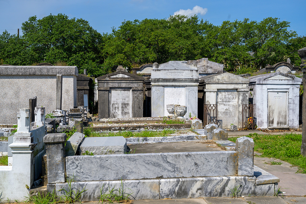 New Orleans, LA, USA -- May 26, 2019.  Photo taken of marble tombstones at St Louis Cemetery #3 on a hot sunny day.