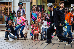 "Lavon Patterson ""Invincible"" lead a dance workshop at Tutu Park Mall.  Dancers from Invicible, a Michael Jackson tribute, will perform at Reichhold Center for the Arts Saturday at 7pm.  Tutu Park Mall.  1 November 2013.  © Aisha-Zakiya Boyd"