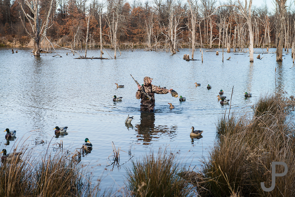 Vance Fielder resetting decoys while duck hunting near Shamrock, Oklahoma