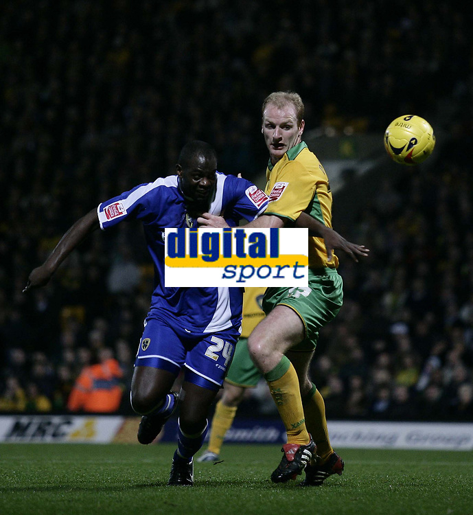 Photo: Barry Bland.<br />Norwich City v Cardiff City. Coca Cola Championship.<br />01/11/2005.<br />Norwich's Gary Doherty (rt) and Cardiff's  Michael Ricketts.