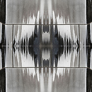 Photographic series of digital computer art from an image of Weathered Sculpture Abstract.<br /> <br /> Two or more layers were used to enhance, alter, manipulate the image, creating an abstract surrealistic mirrored symmetry.