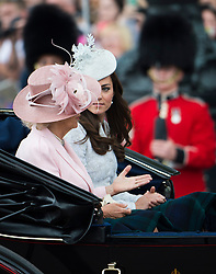 © London News Pictures.. 14/06/2014. Camilla, Duchess of Cornwall (left) and Catherine, Duchess of Cambridge (right) , riding in a carriage from Buckingham Palace during the annual Trooping the Colour Ceremony in central London. The event marks the queens official birthday. . Photo credit:Ben Cawthra/LNP