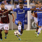 Mikel, Chelsea, is challenged by Antonio Nocerino, AC Milan, (left),  during the Chelsea V AC Milan Guinness International Champions Cup tie at MetLife Stadium, East Rutherford, New Jersey, USA.  4th August 2013. Photo Tim Clayton