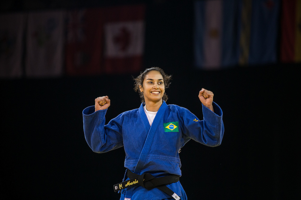 Mariana Silva of Brazil celebrates her victory over Diana Velasco of Colombia in the bronze medal contest in the women's judo -63kg class at the 2015 Pan American Games in Toronto, Canada, July 13,  2015.  AFP PHOTO/GEOFF ROBINS