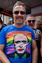 © Licensed to London News Pictures. 08/07/2017. London, UK. A man wears a Vladimir Putin T shirt in the crowd.  Tens of thousands of visitors, many wearing eye-catching costumes, gather to watch and take part in the annual Pride in London Parade, the largest celebration of the LGBT+ community in the UK.   Photo credit : Stephen Chung/LNP