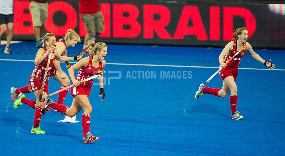 The England players run on to the pitch after winning the shoot out. England v The Netherlands - Final Unibet EuroHockey Championships, Lee Valley Hockey & Tennis Centre, London, UK on 30 August 2015. Photo: Simon Parker