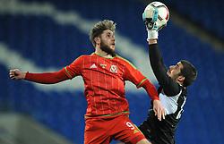 Wes Burns of Wales u21s (Bristol City) challenges for the ariel ball with Aleksandar Lyubenov of Bulgaria u21s - Photo mandatory by-line: Dougie Allward/JMP - Mobile: 07966 386802 - 31/03/2015 - SPORT - Football - Cardiff - Cardiff City Stadium - Wales v Bulgaria - U21s International Friendly