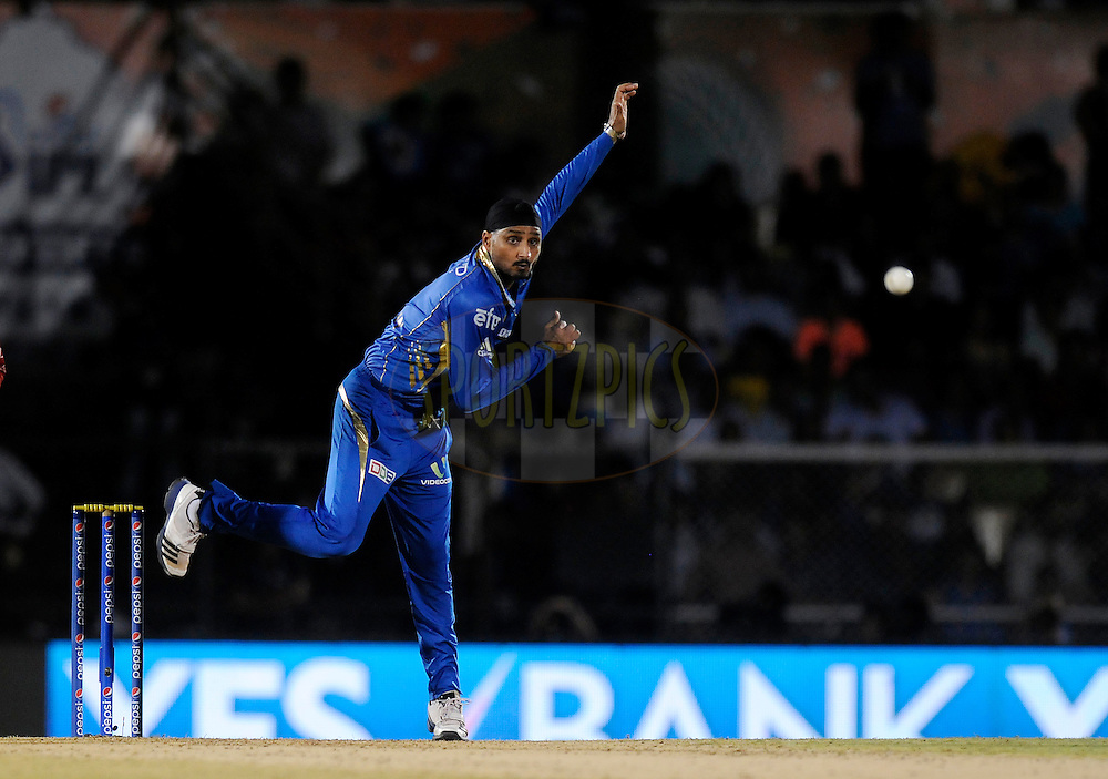Harbhajan Singh of the Mumbai Indians bowls during the eliminator match of the Pepsi Indian Premier League Season 2014 between the Chennai Superkings and the Mumbai Indians held at the Brabourne Stadium, Mumbai, India on the 28th May  2014<br /> <br /> Photo by Pal PIllai / IPL / SPORTZPICS<br /> <br /> <br /> <br /> Image use subject to terms and conditions which can be found here:  http://sportzpics.photoshelter.com/gallery/Pepsi-IPL-Image-terms-and-conditions/G00004VW1IVJ.gB0/C0000TScjhBM6ikg