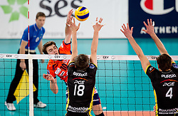 Uros Kovacevic of ACH vs Michal Bakiewicz and Daniel Plinski of Belchatow during volleyball match between ACH Volley LJUBLJANA and  PGE Skra Belchatow (POL) of 2012 CEV Volleyball Champions League, Men, League Round in Pool F, 4th Leg, on December 20, 2011, in Arena Stozice, Ljubljana, Slovenia. (Photo By Vid Ponikvar / Sportida.com)
