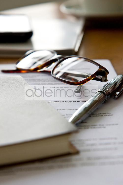 Paperwork, Eyeglasses, Notebook and Pen