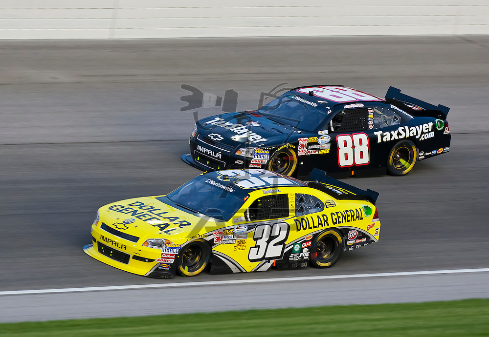 JOLIET, IL - JUNE 04, 2011:  Reed Sorenson (32) battles for position during the STP 300 race at the Chicagoland Speedway in Joliet, IL.