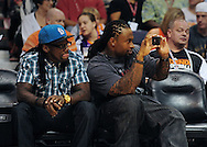 Nov. 5 2010; Phoenix, AZ, USA; Arizona Cardinals players Greg Toler (left) and Darnell Dockett sit court side during the game between the Phoenix Suns and the Memphis Grizzlies at the US Airways Center. The Suns defeated the Memphis Grizzlies in double over time 123 - 118.  Mandatory Credit: Jennifer Stewart-US PRESSWIRE.