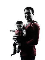 one man fathers parents with baby carrier  in silhouettes on white background