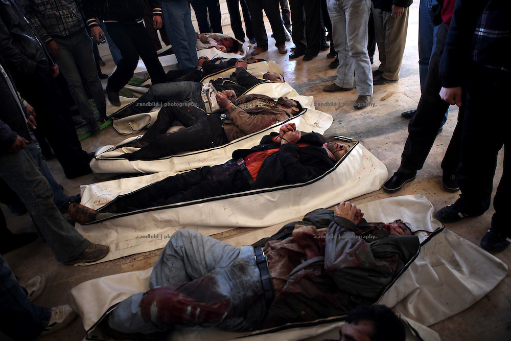 Seven bodies of exectued men are temporary layed on the ground of a mosque in Idlib, Province of Idlib, Syria. The men were apparently totured before they were shot dead.