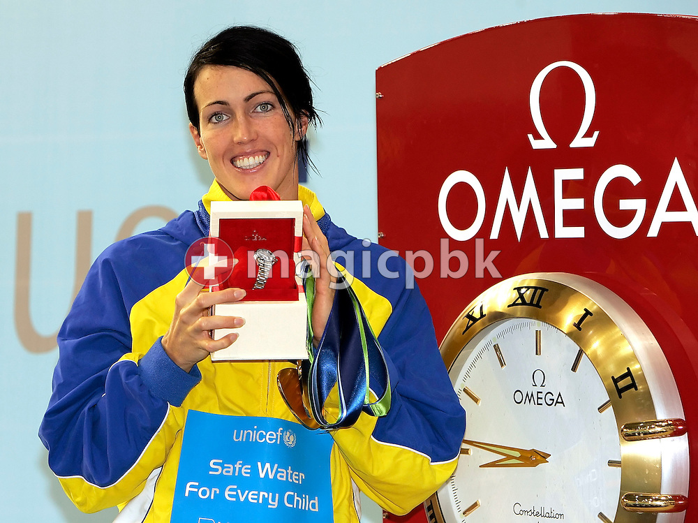 Therese Alshammar of Sweden wins an Omega watch for the best female performance on day two at the European Short-Course Swimming Championships at the Maekelaenrinne Swimming Centre in Helsinki, Finland, Friday December 8, 2006. (Photo by Patrick B. Kraemer / MAGICPBK)