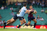 SYDNEY, NSW - MARCH 09: Reds player Duncan Paia'aua (12) tackled by Waratahs player Karmichael Hunt (12) at round 4 of Super Rugby between NSW Waratahs and Queensland Reds on March 09, 2019 at The Sydney Cricket Ground, NSW. (Photo by Speed Media/Icon Sportswire)