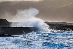 © Licensed to London News Pictures. 30/11/2018. Aberystwyth, UK. Strong gale force winds continue hammer huge waves against the sea defences in Aberystwyth on the Cardigan Bay coast of west Wales. Photo credit: Keith Morris/LNP