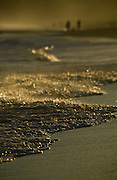 Summer afternoon beach walk in a  setting sun's golden light, East Coast Australia