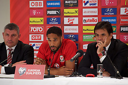 VIENNA, AUSTRIA - Wednesday, October 5, 2016: Wales manager Chris Coleman (R) with Wales captain Ashley Williams (C) and assistant manager Osian Roberts during a press conference at the Ernst-Happel-Stadion ahead of the 2018 FIFA World Cup Qualifying Group D match against Austria. (Pic by Peter Powell/Propaganda)