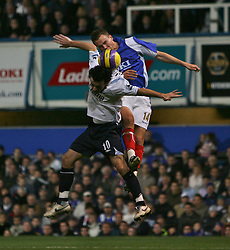 PORTSMOUTH, ENGLAND - SATURDAY, DECEMBER 9th, 2006: Matthew Taylor of Portsmouth clashes with Simon Davies of Everton during the Premiership match at Fratton Park. (Pic by Chris Ratcliffe/Propaganda)