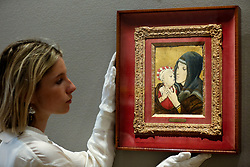 © Licensed to London News Pictures. 25/02/2019. London, UK. A woman views Vierge et enfant by Leonard Tsuguharu Foujiya. Painted circa 1953. Estimate £100,000-150,000<br /> Bonhams Impressionist and Modern Art Sale will take place in London on 28 February 2019. Photo credit: Dinendra Haria/LNP