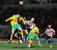 Doncaster - Friday January 30th 2009:\ncfc of Norwich City & \dr of Doncaster Rovers in action during the Coca Cola Championship Match at The Keepmoat Stadium Doncaster. (Pic by Steven Price/Focus Images)