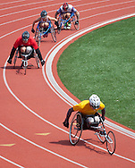 West Point, New York - Army's Matthew Spang, right, takes the lead in the wheelchair 1,500-meter race at the 2014 Army Warrior Trials at the United States Military Academy Preparatory School on Tuesday, June 17, 2014.<br />