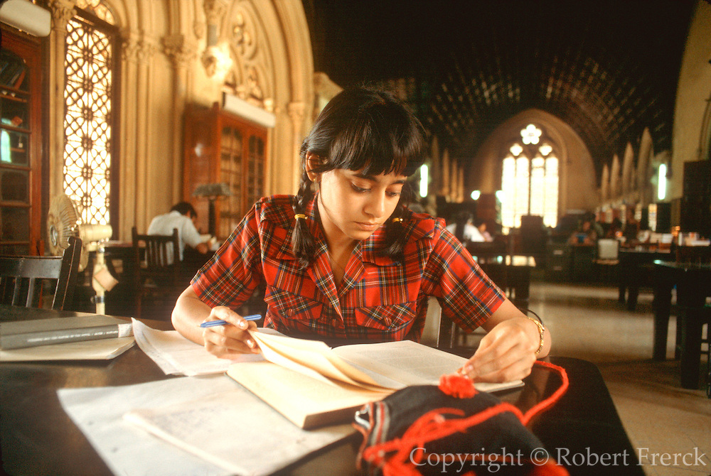 INDIA, MUMBAI, EDUCATION student studying in the library of Mumbai University (Bombay)