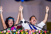 "10 JANUARY 2007 - MANAGUA, NICARAGUA:  ROSARIO MURILLO and her husband, DANIEL ORTEGA, President of Nicaragua, clasp hands during Ortega's inaugural speech in Managua. Ortega, the leader of the Sandanista Front, was sworn in as the President of Nicaragua Wednesday. Ortega and the Sandanistas ruled Nicaragua from their victory of ""Tacho"" Somoza in 1979 until their defeat by Violetta Chamorro in the 1990 election.  Photo by Jack Kurtz"