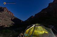 Tents at Cottonwood Campground under a full moon in Grand Canyon National Park, Arizona, USA