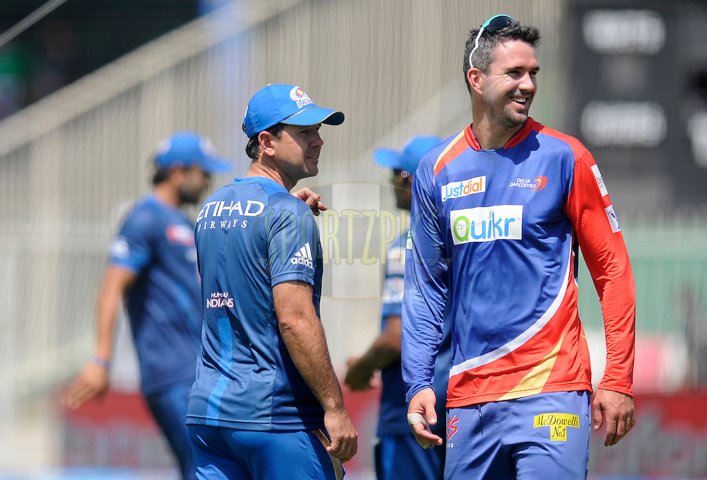 Ricky Ponting of Mumbai Indians chats with Kevin Pietersen captain of of the Delhi Daredevils during a warm up before the start of match 16 of the Pepsi Indian Premier League 2014 between the Delhi Daredevils and the Mumbai Indians held at the Sharjah Cricket Stadium, Sharjah, United Arab Emirates on the 27th April 2014<br /> <br /> Photo by Pal Pillai / IPL / SPORTZPICS
