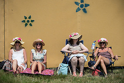Image ©Licensed to i-Images Picture Agency. 18/07/2014  Henham Park , Suffolk, United Kingdom. Women in sunhats at Henham Park on what is forecast to be the hottest day of the year so far with temperatures due to hit 30 degrees centigrade. The Latitude Festival of music and arts. Picture by Joel Goodman / i-Images