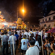 Thousands of worshipers gather to see the urns containing the spirits of the nine emperors.