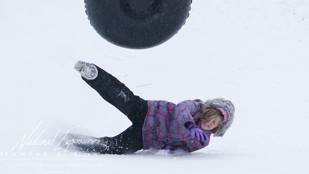 An unidentified young girl sledding on Pete's Hill. Bozeman, Montana