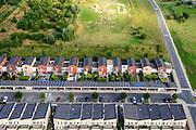 Nederland, Flevoland, Gemeente Almere, 27-08-2013; nieuwbouwwijk Noorderplassen. Zonnecollectoren op de daken van de carport.<br /> Solar collectors on the roof of new constructed houses of a new residential district in Almere.<br /> luchtfoto (toeslag op standaard tarieven);<br /> aerial photo (additional fee required);<br /> copyright foto/photo Siebe Swart.