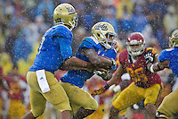 17 October 2012: Quarterback (17) Brett Hundley of the UCLA Bruins hands the ball off to (23) Jonathan Franklin against the USC Trojans during the second half of UCLA's 38-28 victory over USC at the Rose Bowl in Pasadena, CA.