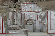 Interior of a Terrace House with frescoes on the walls on Bulbul Hill, opposite the Temple of Hadrian, Ephesus, Izmir, Turkey. These houses are also called the houses of the rich and were built according to the Hippodamian plan of the city in which roads transected each other at right angles. There are 6 residential units on 3 terraces at the lower end of the slope. The oldest building dates to the 1st century BC and continued in use as a residence until the 7th century AD. Ephesus was an ancient Greek city founded in the 10th century BC, and later a major Roman city, on the Ionian coast near present day Selcuk. Picture by Manuel Cohen