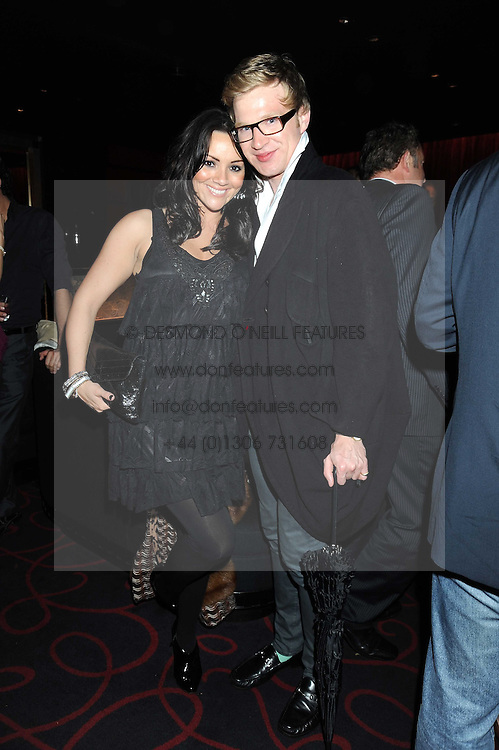 MARTINE MCCUTCHEON and HENRY CONWAY at a private party following the first night of 'Fat Pig' held at L'Atelier, 13-15 West Street, London WC2 on 20th October 2008.