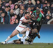 Twickenham, GREAT BRITAIN, Quins Ugo MONGO, breaks through the combined tackle from left Kevin SORRELL and Richard HAUGHTON, during the Guinness Premiership game Harlequins [Quins] vs Saracens at the Stoop, Middx, 22/12/2007  [Mandatory Credit Peter Spurrier/Intersport Images]