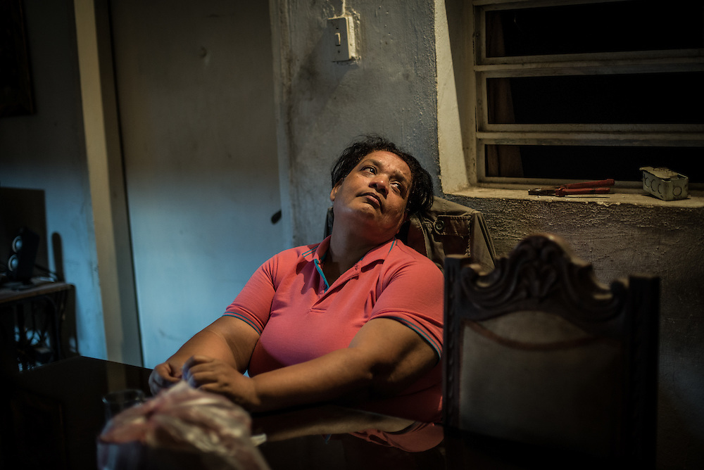 "MARACAY, VENEZUELA - JULY 15, 2016: Evelin RodrÍguez sighs in frustration while explaining how difficult her life is caring for her two schizophrenic sons, Gerardo and Accel, in a country suffering from severe shortages of medicines, including the psychiatric drugs that she needs to keep her sons' conditions stabilized. It is an exhausting task taking care of them and going from pharmacy to pharmacy for hours searching for the medicines that her sons need, that she is rarely able to find. She copes by reducing their doses, and by sharing their prescriptions depending on which son needs the medicine the most each day. Evelin is a lawyer, but has quit all of her work since Accel attempted to cut off his arm after three weeks without his medicine. Evelin now spends her days looking after Accel and Gerardo, too afraid to leave them alone because they might hurt themselves.  ""I am tired,"" she said. ""This is too much sometimes"". PHOTO: Meridith Kohut for The New York Times"