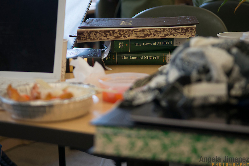 Jewish law texts on the laws of Niddah, or laws pertaining to women's menstruation, sit on the table in the main study room at Drisha. <br /> <br /> The female students of Yeshivat Maharat, &quot;the first institution to train Orthodox women as spiritual leaders and halakhic authorities,&quot; study at the Drisha Institute in New York City in preparation for the school's inaugural graduation on June 16, 2013. <br /> <br /> Three women will be the first to graduate from the four-year school and will be given the title &quot;Maharat&quot;, a Hebrew acronym for &quot;Manhiga Hilkhatit Rukhanit Toranit&quot; which translates to a teacher of Jewish law and spirituality.The school, which currently has 14 students, was founded by Rabbi Avi Weiss. Rabbi Wiess controversially ordained the first female Orthodox Rabba in history, Rabba Sara Hurwitz, who serves as the dean of the school. <br /> <br /> <br /> Photo by Angela Jimenez <br /> www.angelajimenezphotography.com