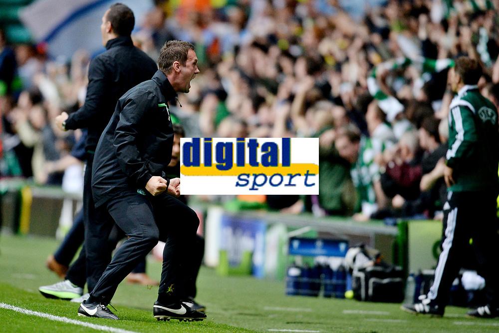 19/08/15 UEFA CHAMPIONS LEAGUE PLAY-OFF 1ST LEG<br /> CELTIC V MALMO<br /> CELTIC PARK - GLASGOW<br /> Celtic manager Ronny Deila celebrates in the dugout.