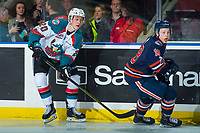 KELOWNA, CANADA - FEBRUARY 24:  Conner Bruggen-Cate #20 of the Kelowna Rockets passes the puck away from Connor Zary #18 of the Kamloops Blazers on February 24, 2018 at Prospera Place in Kelowna, British Columbia, Canada.  (Photo by Marissa Baecker/Shoot the Breeze)  *** Local Caption ***