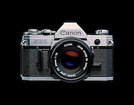 The Canon AE-1 is a 35 mm single-lens reflex (SLR) film camera for use with interchangeable lenses. It was manufactured by Canon Camera K. K. (today Canon Incorporated) in Japan from April 1976 to 1984. It uses an electronically controlled, electromagnet horizontal cloth focal plane shutter, with a speed range of 2 to 1/1000 second plus Bulb and flash X-sync of 1/60th second. The AE-1 is a historically significant SLR, both because it was the first microprocessor-equipped SLR and because of its sales. Backed by a major advertising campaign, the AE-1 sold over one million units, which made it an unprecedented success in the SLR market.