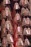 Malaysia, Kuala Lumpur. Chinatown. Burning incense at Guan Di Temple.