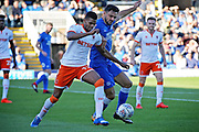 Peterborough United defender Ryan Tafazolli (5) tries to get past Blackpool defender Michael Nottingham (12) during the EFL Sky Bet League 1 match between Peterborough United and Blackpool at The Abax Stadium, Peterborough, England on 29 September 2018.