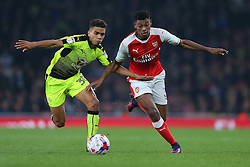 25 October 2016 - EFL Cup - 4th Round - Arsenal v Reading - Jeff Reine-Adelaide of Arsenal tangles with Tennai Watson of Reading - Photo: Marc Atkins / Offside.
