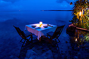 A dinner table is set up in an infinity pool on Song Saa island.