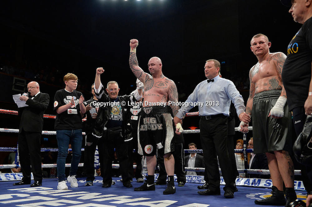 Lucas Browne (black/grey shorts) defeats Andriy Rudenko for the WBA Intercontinental & WBC EUR-ASIA- Pacific Heavyweight Championship at Wolverhampton Civic Hall, Wolverhampton, 1st August 2014. Promoted by Ricky Hatton on the Frank Warren in association with PJ Promotions bill. © Credit: Leigh Dawney Photography.