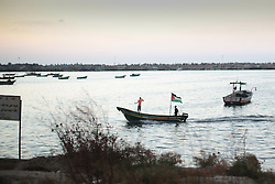 A fishing boat in Gaza flying a Palestinian flag. From a series of photos commissioned by  British NGO, Medical Aid for Palestinians (MAP).